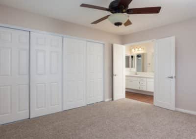 Carpeted bedroom with big closet and bathroom